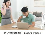 asian couple at home using a... | Shutterstock . vector #1100144087