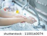 female clean bacteria... | Shutterstock . vector #1100160074
