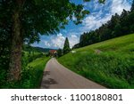 a nice small path to walk on in ... | Shutterstock . vector #1100180801