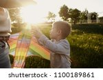 father and son and a kite | Shutterstock . vector #1100189861