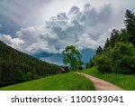a path leading into a stormy... | Shutterstock . vector #1100193041