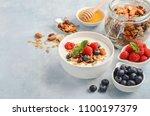 homemade granola with yogurt... | Shutterstock . vector #1100197379