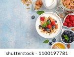 homemade granola with yogurt... | Shutterstock . vector #1100197781