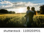 mother and daughter watching... | Shutterstock . vector #1100203931