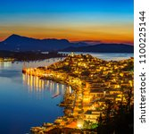 greek town poros at night ... | Shutterstock . vector #1100225144