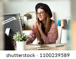 shot of pretty young business... | Shutterstock . vector #1100239589