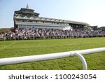 Small photo of A packed crowd in the Grandstand watching horse racing at Thirsk Races : Thirsk Racecourse, Thirsk, North Yorkshire, UK : 19 May 2018 : Pic Mick Atkins