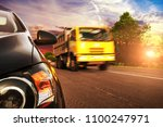 close up of a black car front... | Shutterstock . vector #1100247971