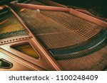 detail from piano interior | Shutterstock . vector #1100248409