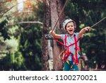 little boy climbing in... | Shutterstock . vector #1100270021