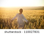 Woman In A Wheat Field On The...