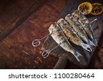 grilled fish on skewers served... | Shutterstock . vector #1100280464