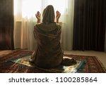 muslim woman praying for allah... | Shutterstock . vector #1100285864