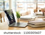 desk with laptop  books and... | Shutterstock . vector #1100305607