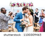 young couple kissing at wedding ... | Shutterstock . vector #1100309465