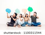 group of friends holding a... | Shutterstock . vector #1100311544