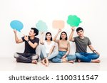 group of friends holding a... | Shutterstock . vector #1100311547