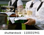 waitress with dish of champagne ... | Shutterstock . vector #110031941