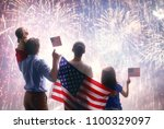 patriotic holiday. happy family ... | Shutterstock . vector #1100329097