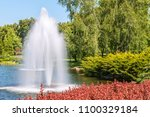 fountain on the lake in the... | Shutterstock . vector #1100329184