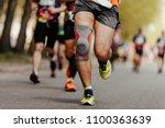 foot runner man in knee pads... | Shutterstock . vector #1100363639