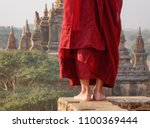 a young monk standing at... | Shutterstock . vector #1100369444