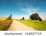 Rural Road In Latvian Landscape.
