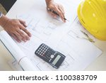 close up of person's engineer... | Shutterstock . vector #1100383709