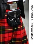 Small photo of Traditional scottish outfit. Kilt and sporran.