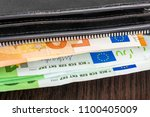 open wallet with euro cash 10... | Shutterstock . vector #1100405009