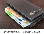 open wallet with euro cash 10... | Shutterstock . vector #1100405135