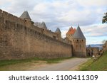 the citadel in carcassonne  a... | Shutterstock . vector #1100411309