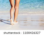 woman walking into the sea ... | Shutterstock . vector #1100426327