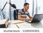 businessman working on laptop...   Shutterstock . vector #1100434301
