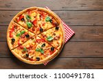 delicious pizza with olives and ... | Shutterstock . vector #1100491781