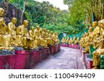 buddha statues on the way to... | Shutterstock . vector #1100494409