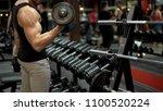 muscleman lifting heavy... | Shutterstock . vector #1100520224