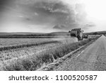 tractor on a wheat field. | Shutterstock . vector #1100520587