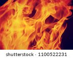 fire flames on black background. | Shutterstock . vector #1100522231