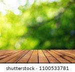 wood paneling and green bokeh...   Shutterstock . vector #1100533781