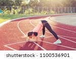 young woman doing gymnastic... | Shutterstock . vector #1100536901