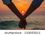 Couple Holding Hands At Sea...