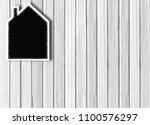 house shaped chalkboard over... | Shutterstock . vector #1100576297