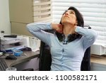 tired neck. young office worker ... | Shutterstock . vector #1100582171