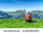 swiss alps. a woman in a white... | Shutterstock . vector #1100582891