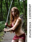 Young Woman With Sword At Forest