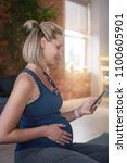 radiant pregnant woman relaxing ... | Shutterstock . vector #1100605901