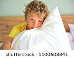 awaked boy with a pillow... | Shutterstock . vector #1100608841