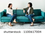 women talking together on the... | Shutterstock . vector #1100617004