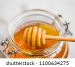 organic honey closeup with... | Shutterstock . vector #1100634275